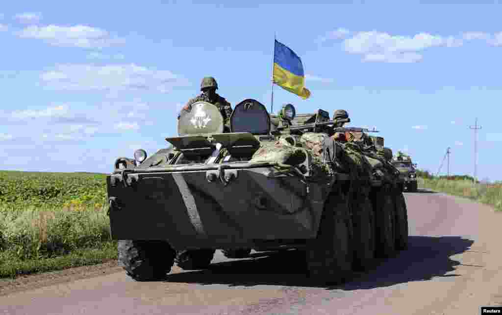 A military vehicle bearing a Ukrainian flag at a checkpoint near Slaviansk in eastern Ukraine, July 3, 2014.