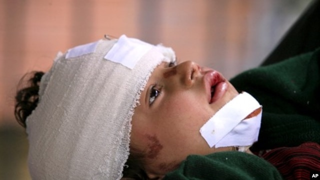 A girl, injured in a Nowshera mosque  bomb explosion, is brought to the Lady Reading hospital for treatment in Peshawar, March 4, 2011