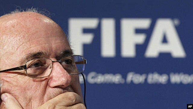 FIFA President Sepp Blatter attends a news conference following the body's executive committee meeting in Tokyo, December 17, 2011.