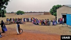 Community members in line to receive drugs during a mass drug administration (MDA) in Mali.