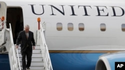 FILE - U.S. Secretary of State Rex Tillerson deplanes in Mexico for a two-day visit, at Benito Juarez airport in Mexico City, Feb. 1, 2018.