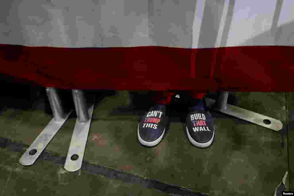 A rallygoer's shoes are seen during a campaign rally with U.S. President Donald Trump in Estero, Florida, Oct. 31, 2018.