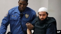 FILE - Ahmad Khan Rahimi, is led into court in Elizabeth, New Jersey, Dec. 20, 2016.