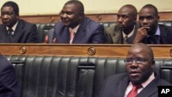 FILE: Tendi Biti, bottom right, Zimbabwe's opposition party Movement for Democratic Change (MDC) secretary general and a member of parliament, Monday Aug. 25, 2008