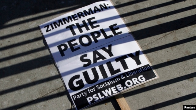 A sign lays on the ground at a protest of the acquittal of George Zimmerman for the 2012 shooting death of Trayvon Martin, in Los Angeles, California July 15, 2013.