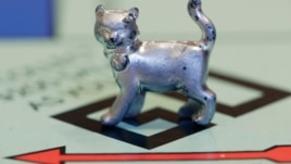 The newest Monopoly token, a cat, rests on the game board at Hasbro Inc. headquarters, in Pawtucket, R.I., Tuesday, Feb. 5, 2013.