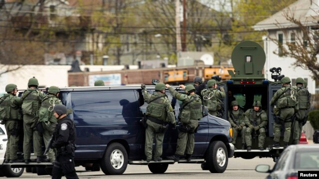 Law enforcement officers in tactical gear during search for Boston bombing suspect Dzhokar Tsarnaev, who was captured in Watertown, Massachusetts, April 19, 2013.