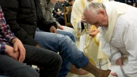 Pope Francis washes the foot of a prisoner at Casal del Marmo youth prison in Rome, Italy, Mar. 28, 2013.