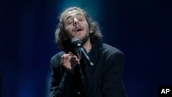 "Salvador Sobral from Portugal performs the song ""Amar pelos dois"" after winning the Final of the Eurovision Song Contest, in Kyiv, Ukraine, May 13, 2017."