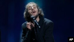 "Salvador Sobral from Portugal performs the song ""Amar pelos dois"" after winning the Final of the Eurovision Song Contest, in Kiev, Ukraine, May 13, 2017."