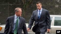 FILE - Former Blackwater Worldwide guard Evan Liberty, right, arrives at federal court in Washington.