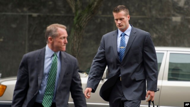 Former Blackwater Worldwide guard Evan Liberty, right, arrives at federal court in Washington, D.C., June 11, 2014.