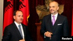FILE - Albania's Prime Minister Edi Rama, right, and President Bujar Nishani, pictured during a government swearing-in ceremony in Tirana, Sept. 15, 2013, are among the officials U.S. Secretary of State John Kerry will confer with Sunday, Feb. 14, 2016.