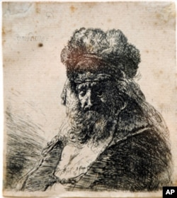 The etching by 17th century Dutch master, Rembrandt Van Rijn, was discovered by Very Rev. David M. O'Connell, C.M., president of The Catholic University of America, in a bathroom at CUA's Nugent Hall, which houses his office. Ed Pfueller/The Catholic Un