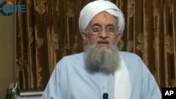 In this image taken from video, Ayman al-Zawahri, head of al-Qaida, delivers a statement in a video which was seen online by the SITE monitoring group, released Sept. 4, 2014.