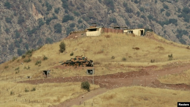 FILE - A tank is seen outside a Turkish military observation point in the mountains of the northern Iraqi region of Dohuk.