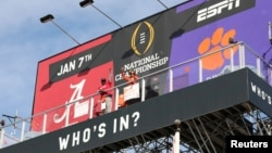 Clemson Tigers fan Nancy Volland and Alabama Crimson Tide supporter Llyas Ross Sr., who have been living on ESPN Billboard ahead of Monday's national championship game as part of an ESPN contest since December 26, 2018, are seen in this photo taken downto