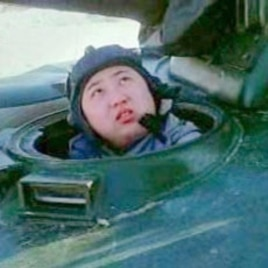 Kim Jong Un shown in documentary in the hatch of a KPA tank.