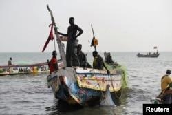 Fishermen land their boat at the beach near the coastal town of Joal-Fadiouth, Senegal, April 10, 2018.