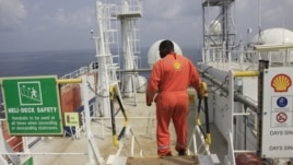 An unidentified Shell worker pictured aboard the Bonga offshore oil vessel off the coast of Nigeria, Dec. 26, 2011.