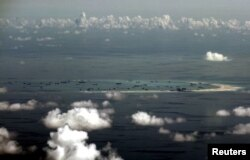 FILE - An aerial photo taken from a Philippine military plane shows reclamation activities by China on Mischief Reef in the Spratly Islands in the South China Sea, west of Palawan, Philippines, May 11, 2015.