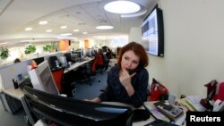 An employee speaks on the phone at the office of the Moscow Exchange, Russia's main venue for trading in stocks, bonds, foreign exchange and derivatives, January 21, 2013.