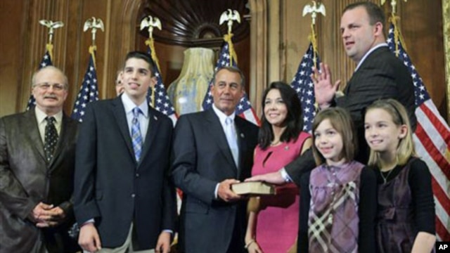 House Speaker John Boehner of Ohio, center, performs the ceremonial swearing-in of Tea Party favorite Rep. Jon Runyan, R-N.J., in Washington, January 5, 2011