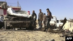 На месте нападения боевиков на правительственные здания в Рамади. 15 января 2012 г.