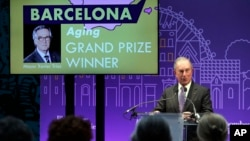 Michael Bloomberg, a billionaire and former mayor of New York, announces the winners of the Bloomberg Philanthropies' 2013-2014 Mayors Challenge. Bloomberg used his wealth to inspire cities with ideas to improve city life. (AP Photo/Christophe Ena)