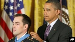 President Barack Obama bestows the Medal of Honor on retired Staff Sgt. Clinton Romesha for conspicuous gallantry, Feb. 11, 2013, in the East Room of the White House. Romesha will be a guest at the State of The Union Address.