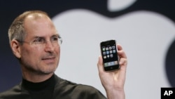 FILE - Apple CEO Steve Jobs holds up an Apple iPhone at the MacWorld Conference in San Francisco, Jan. 9, 2007.