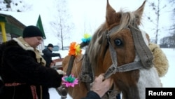 In the village of Vosava, Belarus, men prepare a horse and a sleigh to celebrate the New Year on January 13 according to the Julian calendar, 2017.