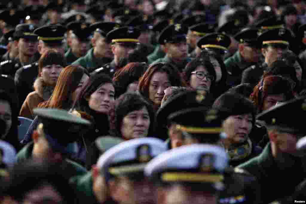 A woman wipes her tears during the 2nd anniversary commemorative ceremony of the attack on Yeonpyeong island, Seoul, South Korea, November 23, 2012.