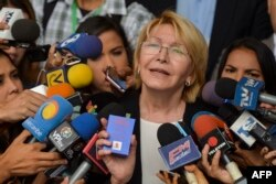 FILE - Venezuela's attorney general Luisa Ortega speaks to journalists outside the Supreme Court of Justice headquarters building in Caracas, June 13, 2017.