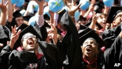 Students celebrate after graduating from Harvard University on May 28, 2015, in Cambridge, Massachusetts.
