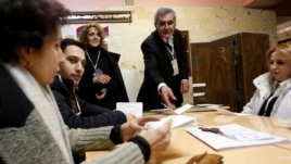 Election officials count ballots after polls closed at a polling station in Yerevan, February 18, 2013. Armenian President Serzh Sarksyan will secure a new five-year term in a election on Monday, an exit poll showed after a vote overshadowed by a lack of