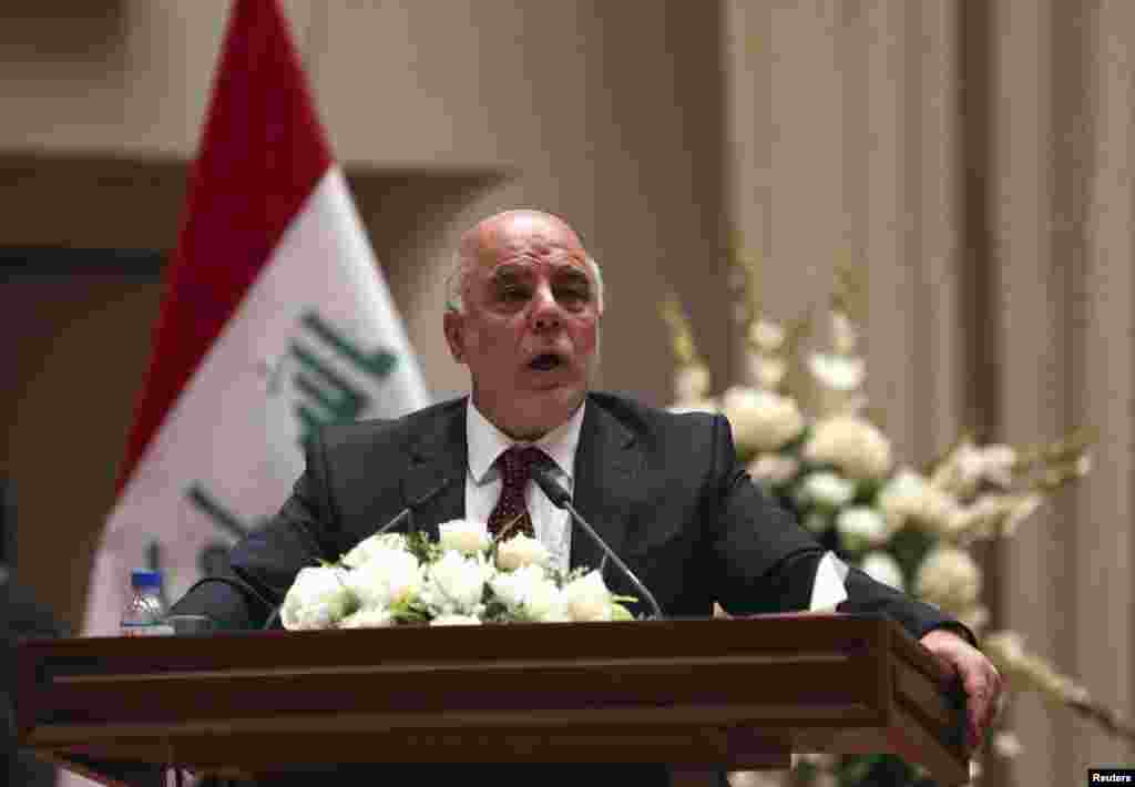 Iraq's incoming Prime Minister Haider al-Abadi speaks to Iraqi lawmakers before submitting his government selections, in Baghdad, Sept. 8, 2014.