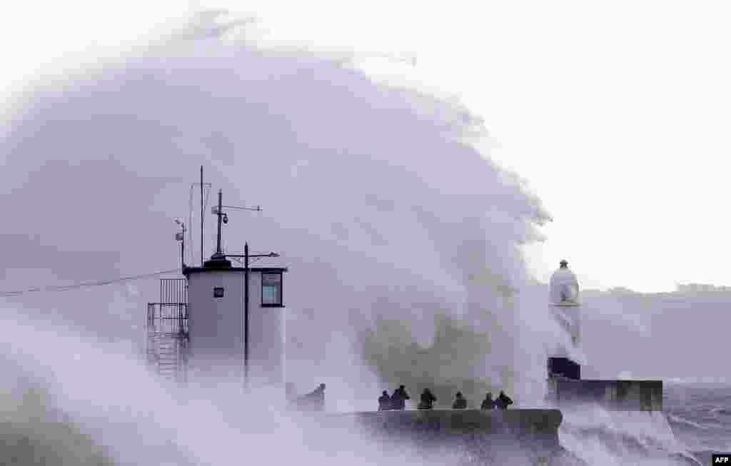 Waves crash against the sea wall at Porthcawl, south Wales, as Storm Ellen brought strong winds across the country.