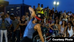 D.C. Bike Party riders often take a break at parks or open areas, where they listen to music and dance.