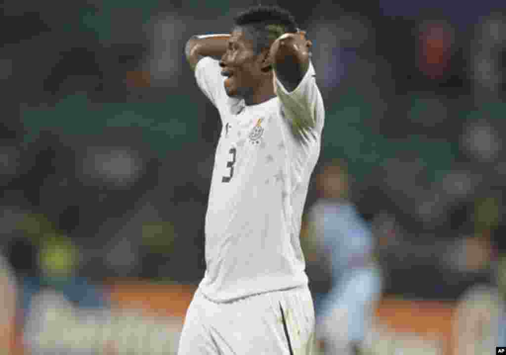Ghana's Asamoah Gyan reacts during their African Cup of Nations Group D soccer match against Botswana in FranceVille Stadium January 24, 2012.