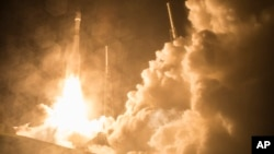 Le décollage de la mission MMS (AP Photo/NASA, Aubrey Gemignani)