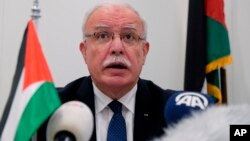 Palestinian Foreign Minister Riad Malki speaks during a press conference at the International Criminal Court, May 22, 2018.