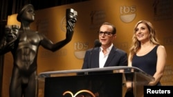 Actors Clark Gregg and Sasha Alexander announce nominees for the 20th Annual Screen Actors Guild Awards at Pacific Design Center's Silver Screen theater in West Hollywood, California, Dec. 11, 2013.