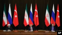 FILE - Turkey's President Recep Tayyip Erdogan, right, Russia's President Vladimir Putin, center, and Iran's President Hassan Rouhani are seen at a news conference following their talks on Syria, in Russia's Black Sea resort of Sochi, Russia, Nov. 22, 2017. The three will be meeting in Ankara, Turkey, Wednesday.