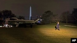 President Barack Obama arrives on the South Lawn of the White House in Washington on Wednesday, Jan. 14, 2015. (AP Photo/Evan Vucci)