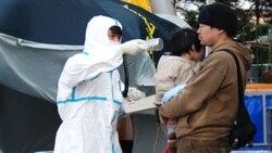 ژاپنی های آسيب ديده از زلزله و سونامی با وضعيت اضطراری اتمی نيز مواجه شده اند