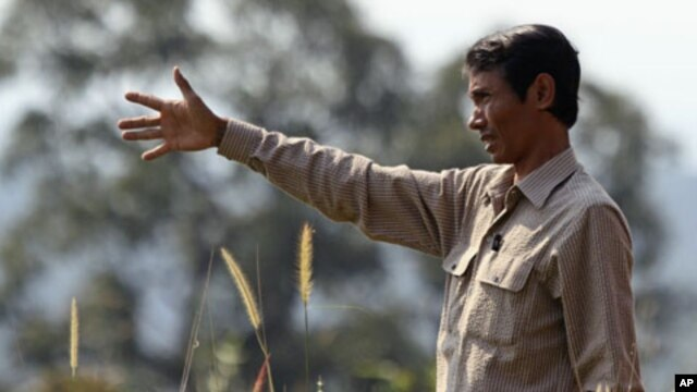 Chut Wutty, Director of the Natural Resource Protection Group, gestures at Botum Sakor National Park in Koh Kong province, Cambodia, February 2012.