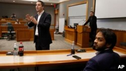 "Lorenzo Vidino, of Milan, Italy, top left, director of the Program on Extremism at George Washington University, addresses an audience during a meeting titled ""Resilience to Violent Extremism: Effective Intervention Approaches,"" at Suffolk Law School, in Boston, Nov. 10, 2015."