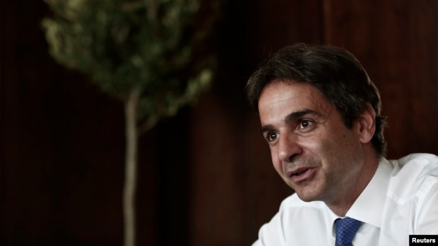 Greece's Administrative Reform Minister Kyriakos Mitsotakis speaks during an interview with Reuters in Athens, July 31, 2013.