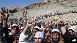 Afghans shout anti-American slogans during an anti-U.S. protest in Ghani Khail, east of Kabul, Afghanistan over the burning of Qurans at a U.S. military base, February 24, 2012 file photo